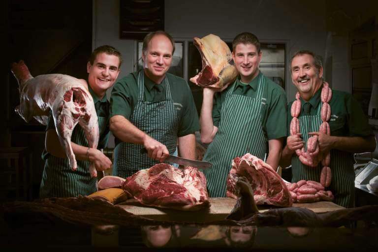 Aune Valley Meat butchers cutting and holding joints of meat