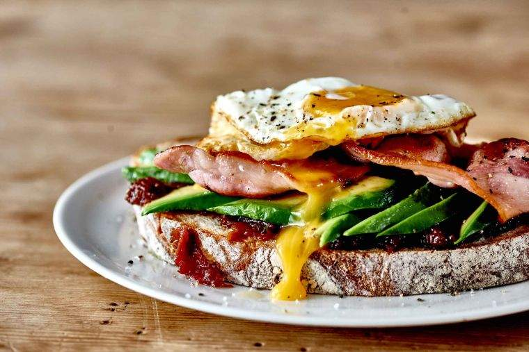Bacon, tomato & tamarind relish with avocado & fried egg on sourdough