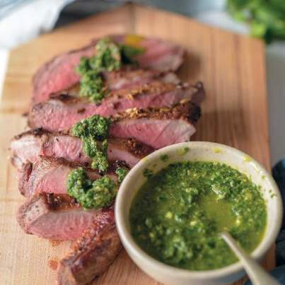 Spiced butterflied leg of lamb with salsa verde sauce