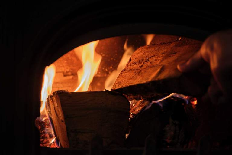 The cosy fireplace at The Cridford Inn