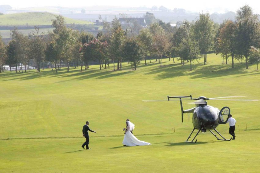Bride arriving by helicopter and Dainton Park