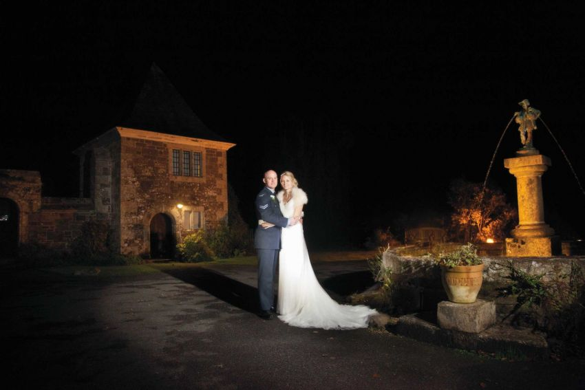 Couple getting married at Lewtrenchard Manor at nighttime