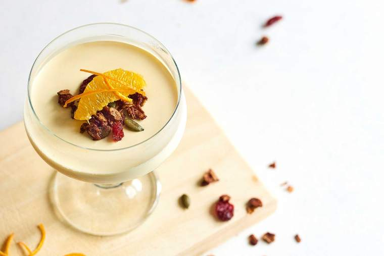 Orange panna cotta with chocolate and pumpkin seed granola