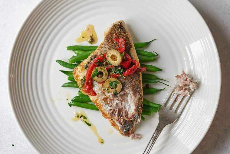 Pan-fried white fish with roasted pepper, caper and olive dressing
