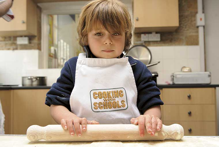 Child cooking in a Devon primary school. Photo by Mike Alsford