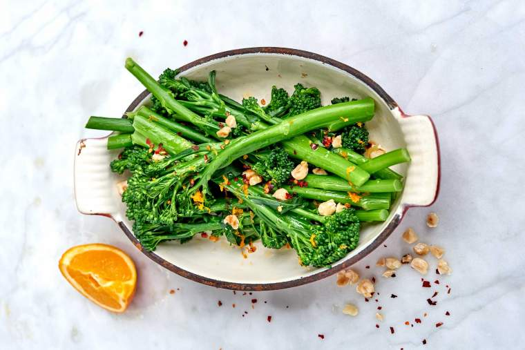 Purple sprouting broccoli with orange, sesame, hazelnuts & chilli flakes recipe