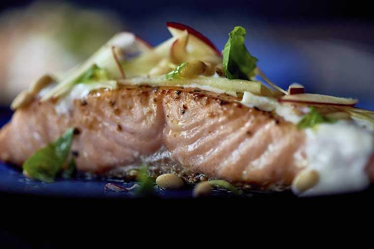 Pan-fried salmon with red apple, pine nuts & basil oil