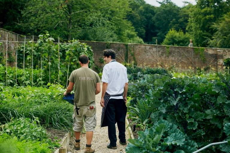 Chef and gardener in the kitchen garden at The Pig at Coombe