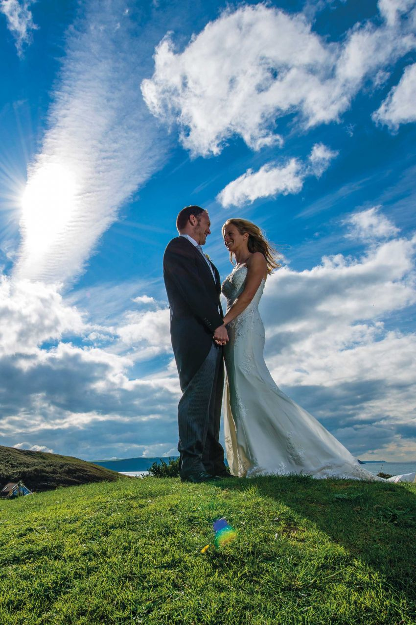 Bride and Groom outside Woolacombe Bay Hotel