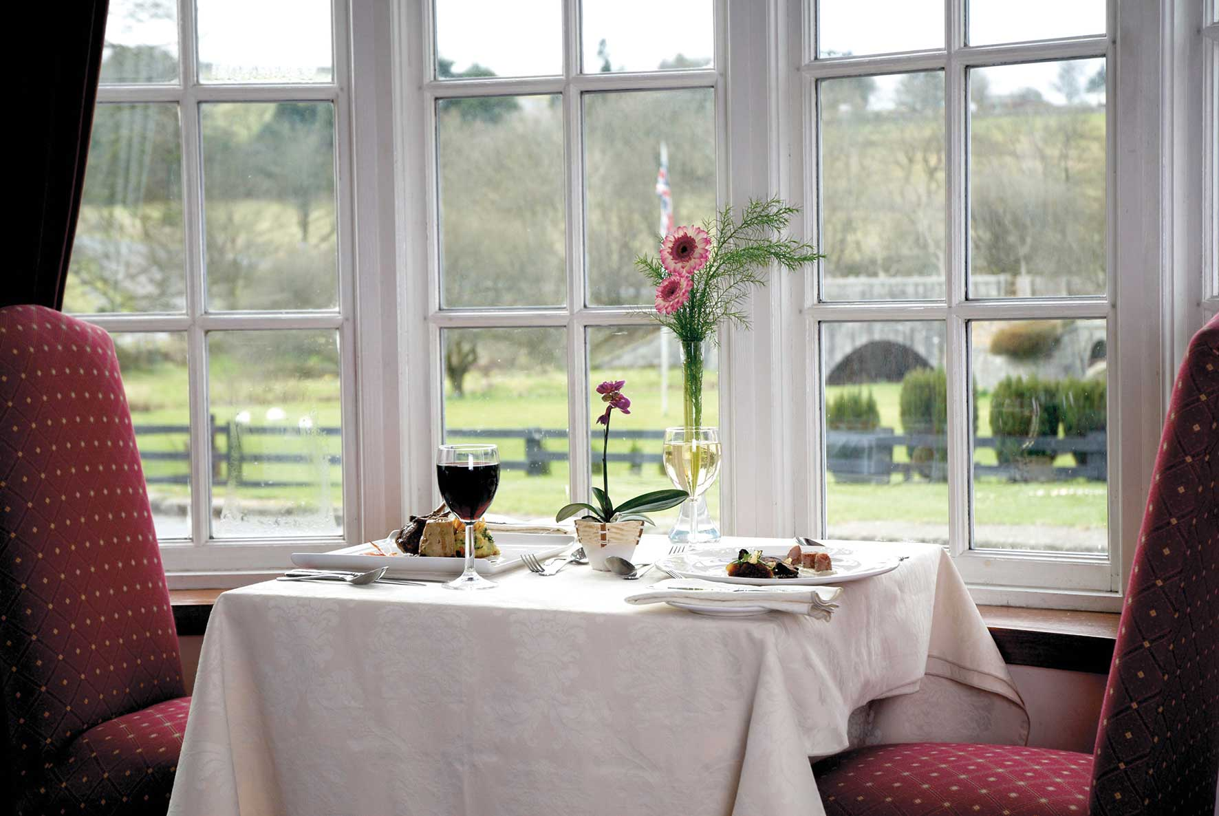 Enjoy views of moorland and the West Dart River from the Two Bridges Hotel